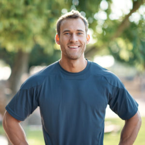 man in blue shirt outdoors